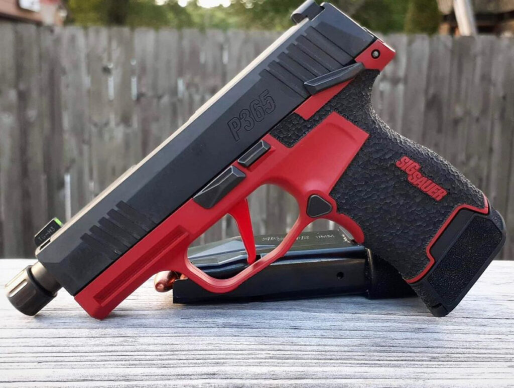 red cerakote gun and stippling by integral defense group