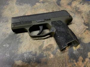 Sig Sauer P365 with od green cerakote and stippling